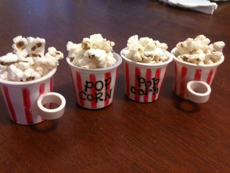 "Scout popcorn slides - clean out a used K-cup, add red stripes around cup with paint or marker, use little letter stickers for ""popcorn"", add popcorn and use hot glue to keep it in the cup.  Hot glue a piece of PVC pipe to the back.  And wear it proudly when selling scout popcorn"