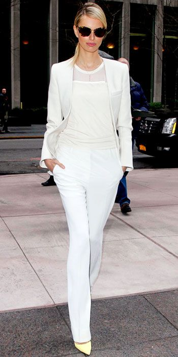 White blazer, white t-shirt, white trousers, and yellow shoes