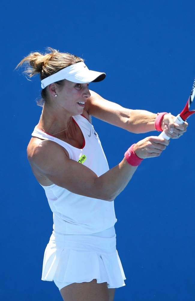 Carina Witthoeft of Germany plays a backhand in her first round match against Mandy Minella of Luxembourg during day two of the 2014 Australian Open at Melbourne Park on January 14, 2014 in Melbourne, Australia. #WTA #Minella #AUSOpen