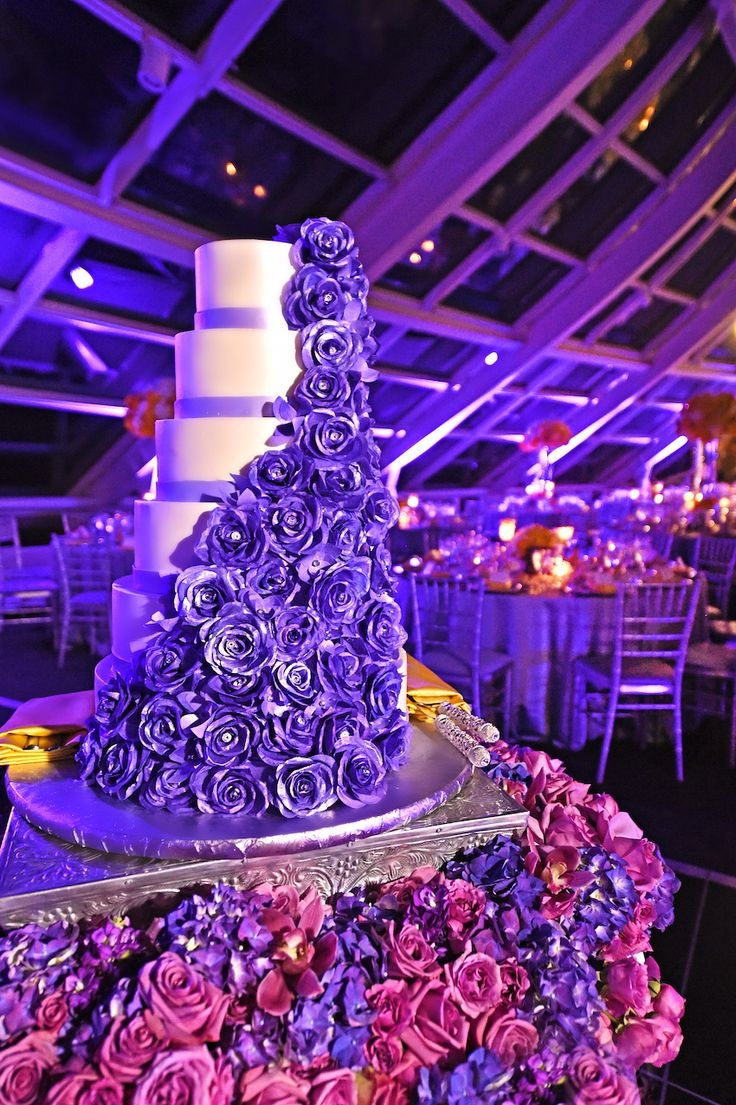 Wedding Cake with Violet Sugar Roses  Photography: Carasco Photography http:/www.carascophoto.com  Read More: http://www.insideweddings.com/weddings/city-wedding-at-chicago-planetarium-with-purple-yellow-palette/688/