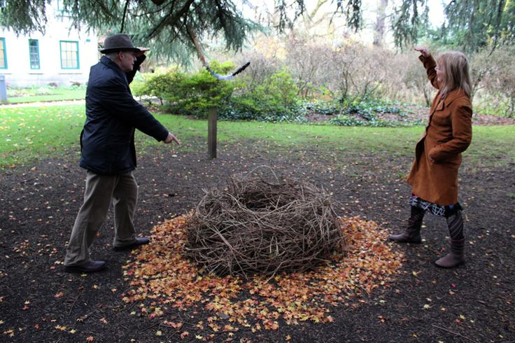C.P.Lee and Pam Lee larking about at Didsbury Parsonage. One of Roger Bygott's 'Nests' - outdoor installation in the parsonage gardens. November 2012.
