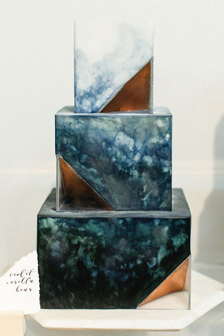 This gorgeous natural marble finished wedding cake is perfect for brides who don't want to do the full geode wedding cake trend but want some natural elements.