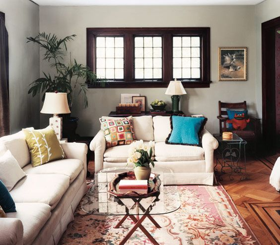 Dark trim on windows, colors scattered everywhere, gray walls - love it