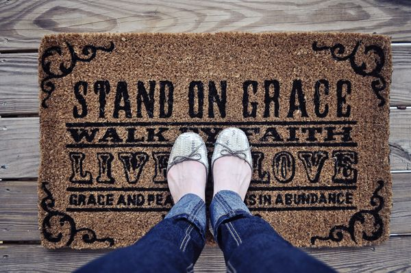 """Stand On Grace, Walk By Faith, Live In Love, Grace and peace be yours in abundance. 1 Peter 1:2"" welcome mat"