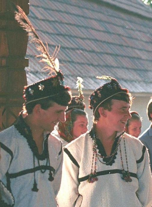 Romanian costume Certeze, zone Oaş - Satu Mare Straw hats (pălărie de paie) with narrow brim, decorated with coloured beads and a single feather.   Photo taken Certeze, zone Oaş in July 1990