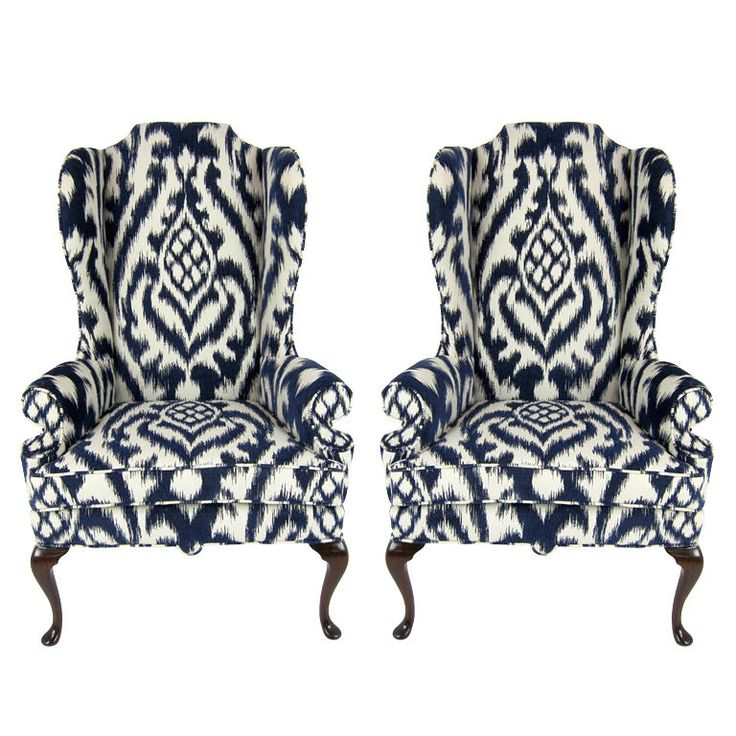 pair of high back wing chairs upholstered in woven ikat