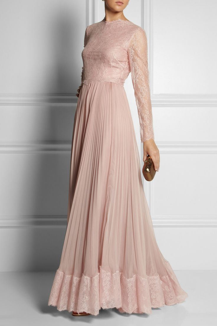 VALENTINO Lace and silk gown $13,000  Valentino's pale-pink gown is cut from flawless lace. The full, pleated silk skirt moves beautifully as you walk - maximize the effect with your highest heels.  Shown here with: Monica Vinader earrings, Aquazzura shoes, Kotur clutch.