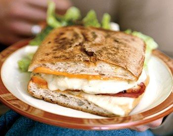 You don't need a panini machine to make these; use the low-tech method of weighting the sandwiches with a baking pan filled with canned goods. If you're making just one or two sandwiches at a time, you can cook them in a skillet and top them with another skillet weighted with cans.