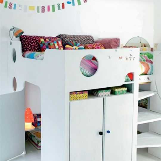 very cool loft bed with built-in wardrobe, reading nook, and twisty stairs to get to the loft.  apartment therapy via marie claire maison.