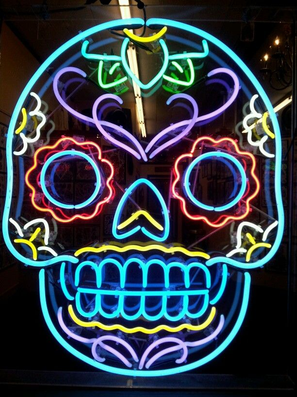 Day of the Dead sugar skull neon sign in a tattoo shop on 6th Street in Austin, Texas