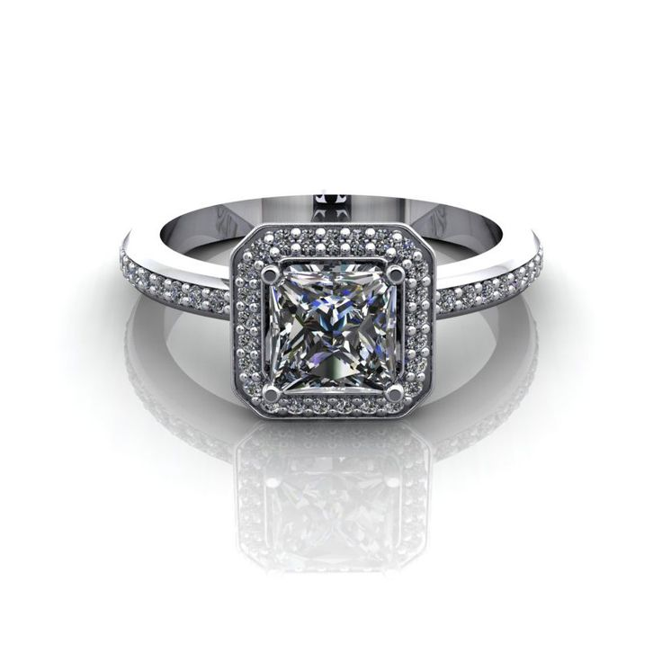 Diamond halo engagement ring by Spexton