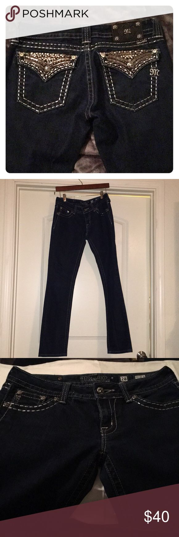 Miss Me Jeans Women's size size 28 jeans. With metallic rhinestone design on pocket as seen in photos. These are a dark indigo color and haven't been worn but a handful of times. They are a skinny straight leg. One of the metal rivets on the left pocket has a slight bend, which is depicted. Miss Me Jeans