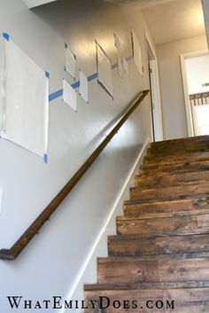 What a great way to space pictures going up a stairway! -the stain on those stairs!