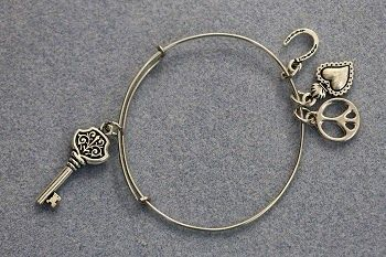 DIY Adjustable Bangle Bracelet with Charms, similar to Alex and Ani bracelets.  Learn to make your own wire bracelet the easy way! Free tutorial from Bead World.