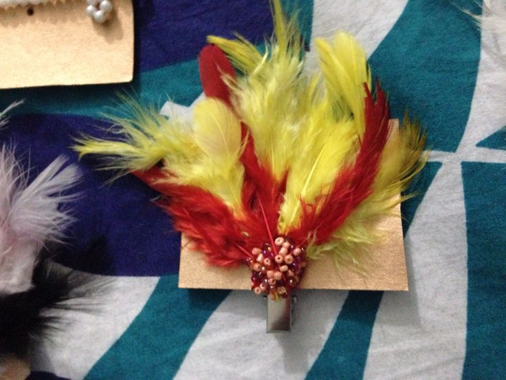 Yellow n red feather hair accesory/clips