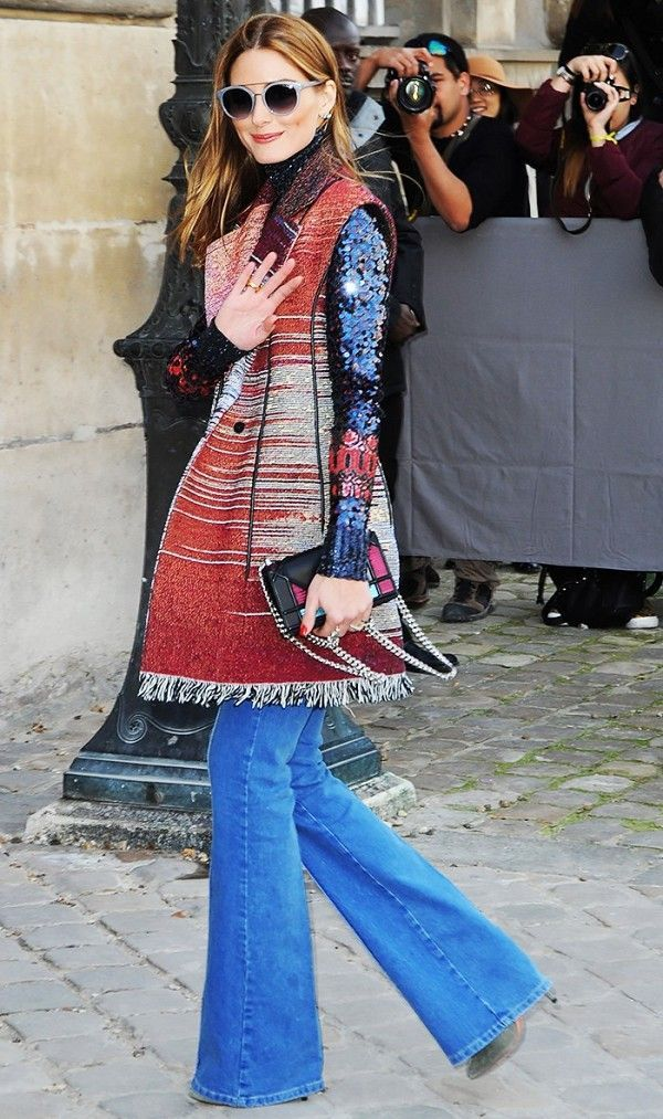 Olivia Palermo tosses a long printed vest over her go-to pair of Reiss jeans