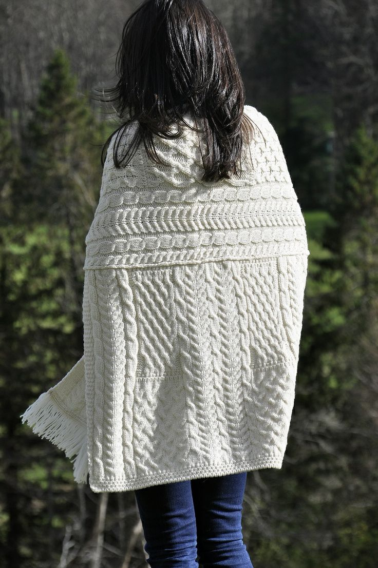 Made from 100% Soft Merino Wool. Back view of our pocket #shawl. Note how it displays  traditional Irish Aran Fisherman patterns.  Aran Knitwear Tradition in the modern world.  Great as a gift; one size fits all.  Colour: Natural, as shown.