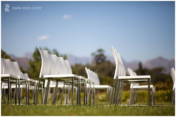 Modern White chairs for outdoor wedding ceremony - ZaraZoo Photography