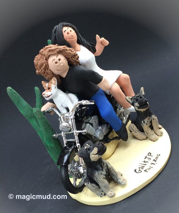 Lesbian Motorcyclist Wedding Cake Toppers custom made for same sex weddings!...handmade to your specifications.     These Lesbians on Motorcycle Wedding Cake Toppers were commissioned for marriage and civil ceremonies involving two women    $235   #magicmud   1 800 231 9814   www.magicmud.com