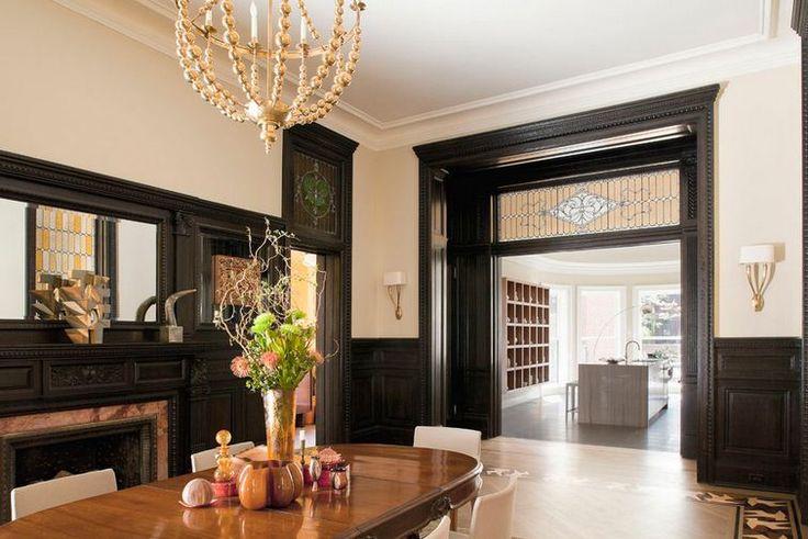 Dark stained wood trim looks black but is dark brown in for Dark doors light walls