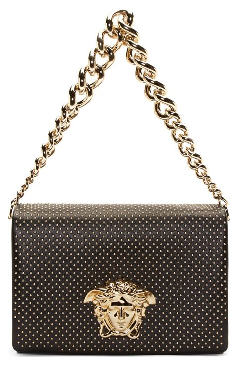 Black Studded Medusa Shoulder Bag by Versace. Structured leather shoulder bag in black. Gold-tone hardware. Gradated curb chain shoulder strap. Foldover flap at main compartment with round micro studs throughout. Large Medusa accent and magnetic press-stud closure at flap. Accordion side panels. Patch pockets at two-compartment interior. http://www.zocko.com/z/JJ6Qr