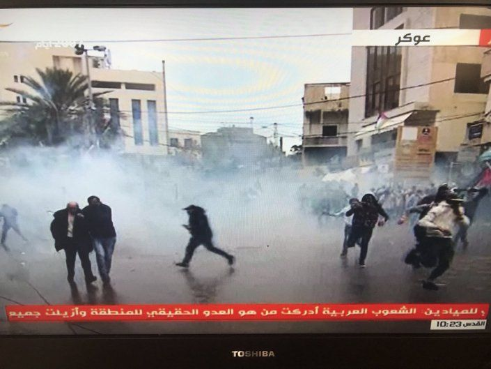Tear gas fired as rioting protesters break down US embassy gates in Beirut