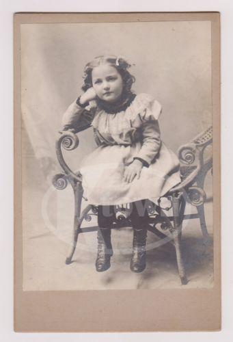 CUTE-LITTLE-GIRL-BLONDE-CURLS-FINE-SHOES-WICKER-CHAIR-ANTIQUE-CABINET-PHOTO