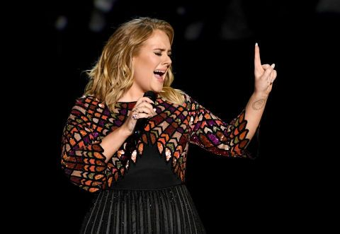 This just in: Apparently Adele sneaks past her fans every night on tour inside a box on wheels. Every night on tour, Adele reportedly climbs into a box on wheels and gets scooted past her fans by security guards, so she can effortlessly make her way to the stage without getting swamped by...