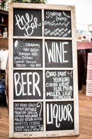 Chalkboard bar menu at rustic chic outdoor tented wedding.