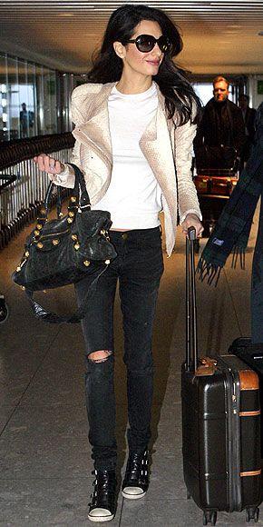 Amal Clooney wearing Alexander McQueen python biker jacket,...