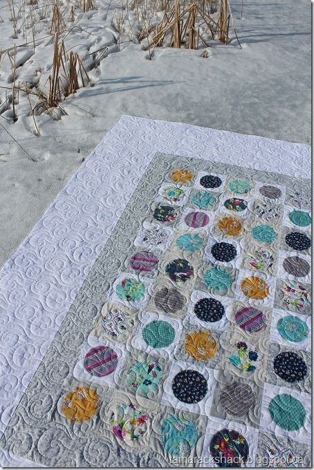 This is Roberta's Pearls quilt and the pattern is designed by Zen Chic. The fabric collection she used is called Gigi Blooms by Adorn It. Roberta first suggested circle quilting designs all over li