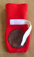 Fleece dog boot with elastic and velcro fastener & non-slip grip on the bottom. Looks incredibly easy to make.