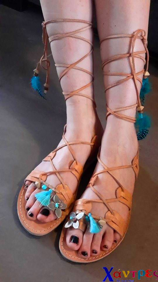 Greek handmade leather sandals decorated with ceramic beads, tassels, metall flower and feathers.