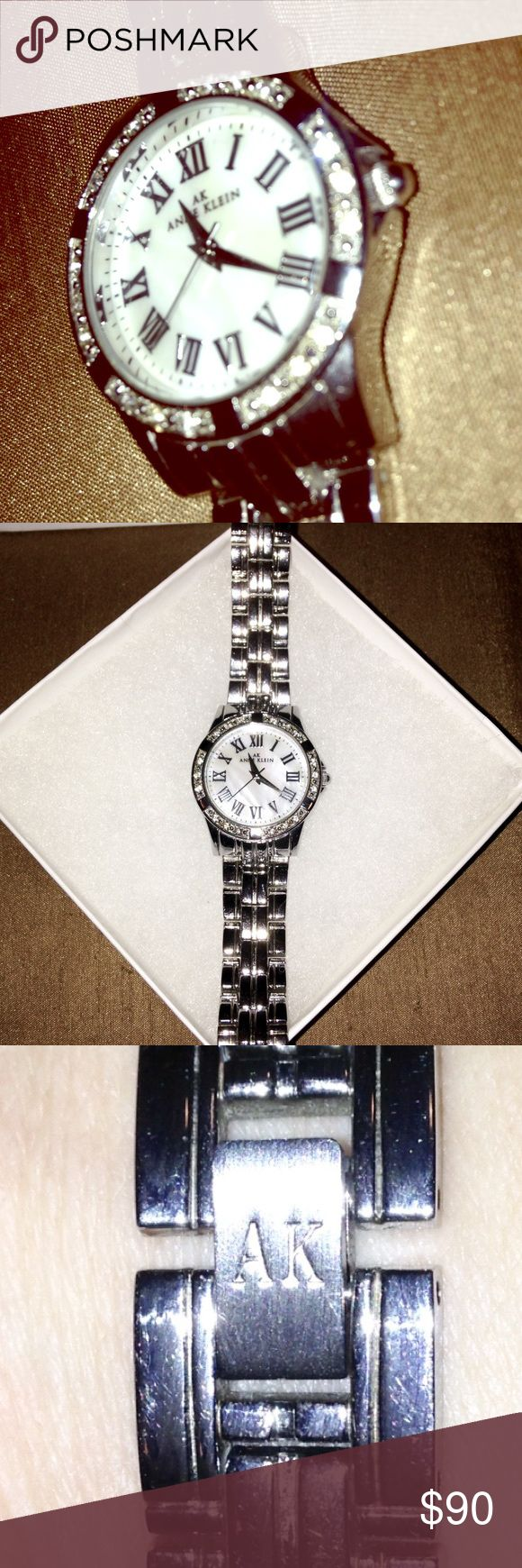 Anne Klein Swarovski Crystal Accented Womens Watch Anne Klein Swarovski Crystal Accented Silver Tone Women's Watch ⌚️ • Opal face w/ a Stainless Steel back • Gorgeous Crystals surrounding the face of the Watch • A Timeless piece  Just needs a new battery! ✨GREAT CONDITION✨ Anne Klein Accessories Watches
