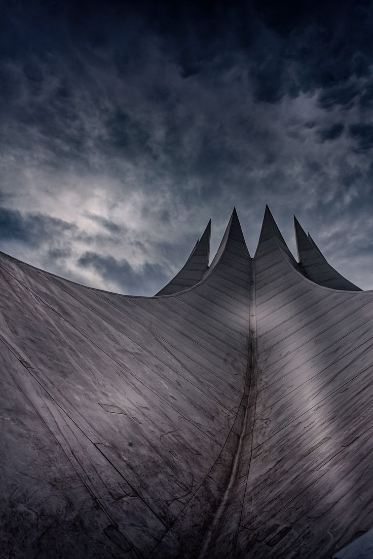 Worms Eye View Photography of Gray Building Under Cloudy Sky