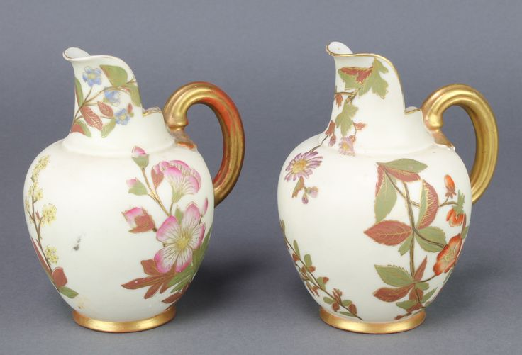 "Lot 3, A pair of Worcester blush porcelain jugs decorated with spring flowers 1094 5"" est £40-60"