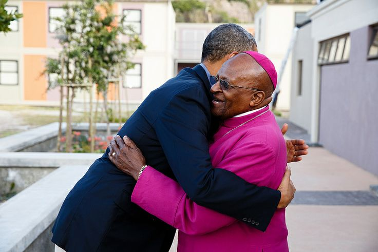 President Obama greets Archbishop Desmond Tutu as he arrives at the Desmond Tutu HIV Foundation Youth Centre in Cape Town, South Africa.