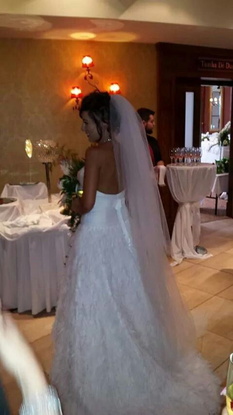 feather wedding dress and long veil