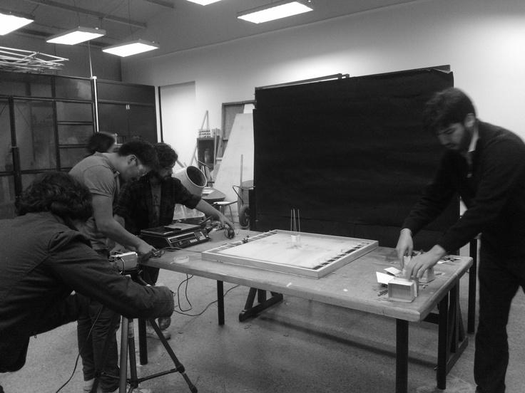 Universidad de Santiago (USACH) students preparing to film the first test of the seismic platform.