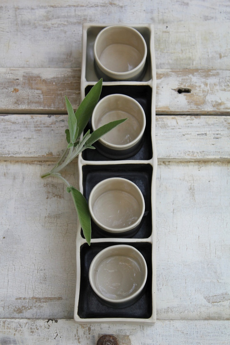 divided porcelain tray with 4 little cups.