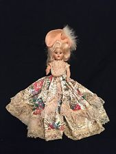 Blonde Vintage Duchess Corp 1948 with feathers in hair