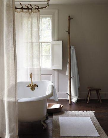 Shower curtain, window, mat, tree hooks.