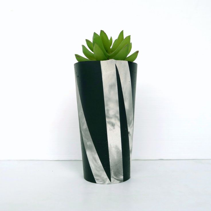 Marble Concrete Design Planter - Designer Series. Designed and hand-made in Australia, these concrete planters are perfect for creating a welcoming outdoor or indoor area. All items are hand-poured and hand set. Slight variations in colour, texture and dimensions can occur due to their artisan nature.