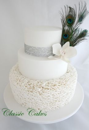 MY FAVORITE!!..simple..but GORGEOUS!...and no one would expect simple from me!..THIS IS IT Ruffles and Peacock Feathers Wedding Cake Sydney - Classic Cakes. www.classiccakes.com.au