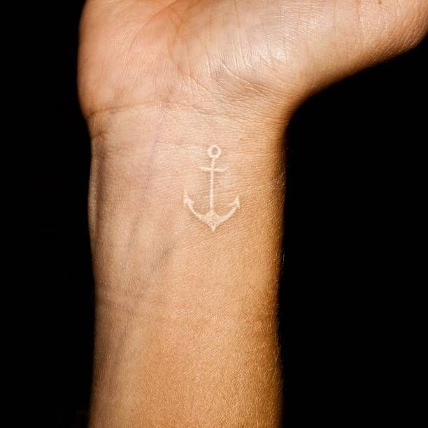 white anchor. I'm not a fan of tattoos but this is very simple and pretty to me I wouldn't mind having this maybe on the inside of my finger or a discrete place like that