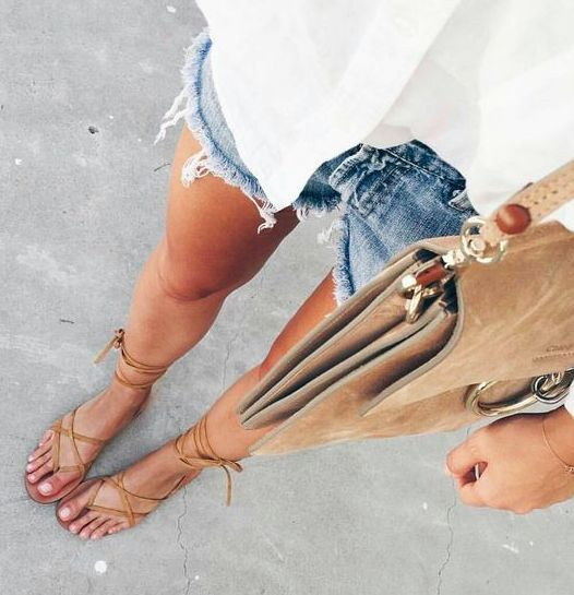 summer simple style. white shirt. denim shorts. #cutoffs tan lace up sandals.
