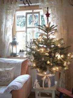 A simple but beautiful Christmas tree. Powder blue lantern in the window.