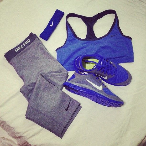 <3 grey nike pro leggings and royal blue sports bra and tennis shoes