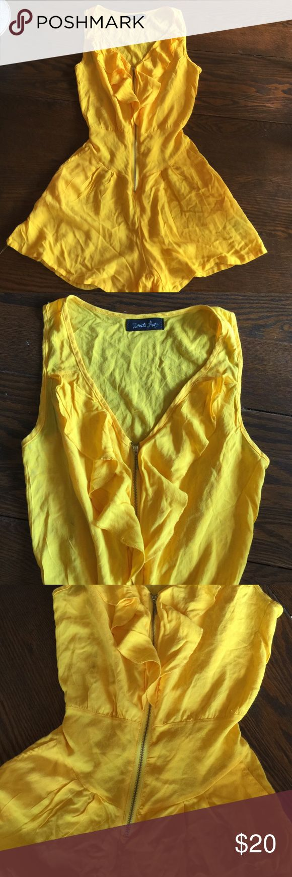 CUTE Bright Sunshiny Yellow Ruffled Romper NEAT ☀️ Super neat!! Great pre loved condition ❤️ Bright sunshiny yellow romper!! This is sleeveless- tank top style, zips up the front, has a Ruffled design down the front, comes together more fitted @ the waist & has a giving stretch on the backside waist. This is a more fitted @ the top 1/2 & more baggier Style shorts. The shorts have a cute small pleated design & pockets!! Super comfy , super pretty, super stylish & just neat neat!! Made by…