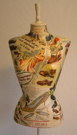 This dressform was made to a shoe shop in Sweden. It is covered by old shoe ads.